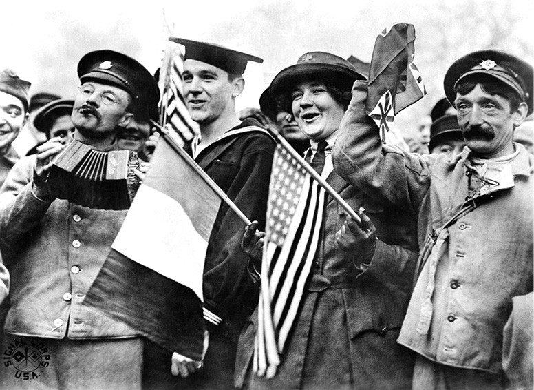 A celebration after the signing of the Armistice, near the Paris Gate on Nov. 11, 1918. - IMPERIAL WAR MUSEUM PHOTO