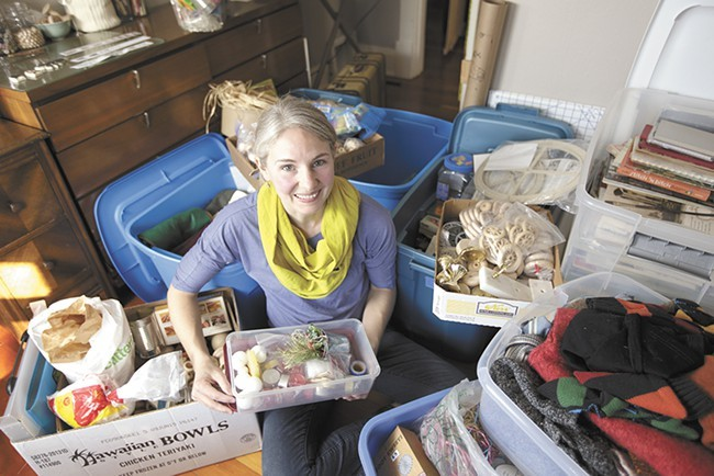 Art Salvage founder Katie Patterson Larson in her craft room with donated materials. - YOUNG KWAK