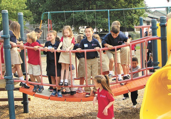 Kids at recess on the first day of school at Spokane International Academy last fall - DANIEL WALTERS