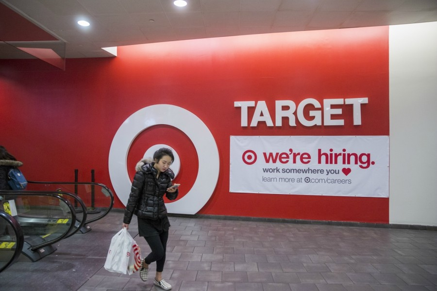 A sign advertises hiring at a Target store in New York, Nov. 19, 2017. Holiday hiring provides an annual jolt to the economy, boosting the incomes of hundreds of thousands of families at Christmas time and providing people a chance to re-enter the labor force, even if only for a few months. - MARK ABRAMSON/THE NEW YORK TIMES