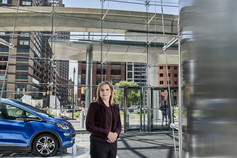 "Mary Barra, the chief executive of General Motors, with a self-driving Chevrolet Bolt EV at GM headquarters in Detroit, June 2, 2017. GM is redirecting energy and capital toward a race with Silicon Valley to create self-driving cars. ""We are very, very serious and intent on putting something on the road,"" Barra said of the company's automated vehicles. ""We definitely want to be first."" - JOE VAUGHN/THE NEW YORK TIMES"