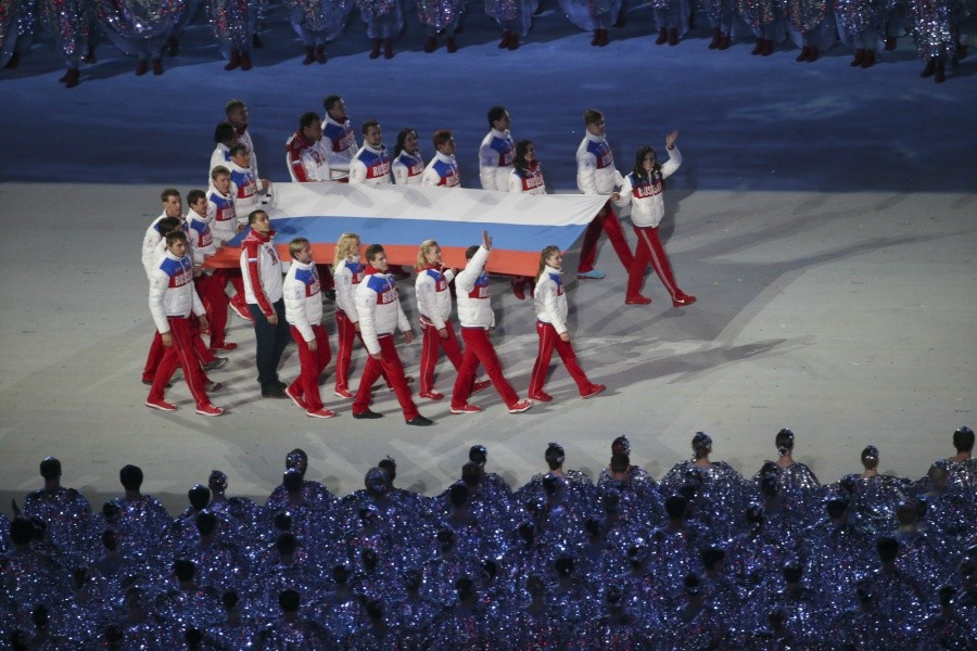 Russian athletes walk in the closing ceremonies for the Winter Olympics, at Fisht Olympic Stadium in Sochi, Russia, Feb. 23, 2014. - JOSH HANER/THE NEW YORK TIMES