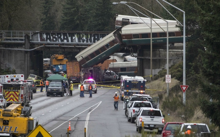 An Amtrak train derailed onto Interstate 5 in Dupont, Wash., on Dec. 18, 2017. Multiple people were killed and more than 75 were taken to local hospitals after an Amtrak train derailed from a highway overpass on Monday morning, according to local authorities. - RUTH FREMSON/THE NEW YORK TIMES