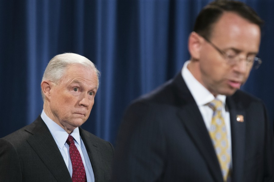 Attorney General Jeff Sessions, the head of the Justice Department, looks on as Deputy Attorney General Rod Rosenstein gives a statement at the Department of Justice in Washington, July 20, 2017. - TOM BRENNER/THE NEW YORK TIMES