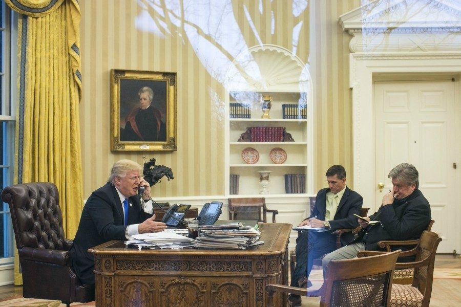 """President Donald Trump takes a call with National Security Advisor Michael Flynn and Stephen Bannon in attendance, in the Oval Office of the White House in Washington, Jan. 28, 2017. Trump essentially excommunicated his former chief strategist on Jan. 3, 2018, saying that Bannon had """"lost his mind"""" in response to reports that Bannon described Donald Trump Jr.'s meeting with Russians as """"treasonous"""" and """"unpatriotic."""" - AL DRAGO/THE NEW YORK TIMES"""