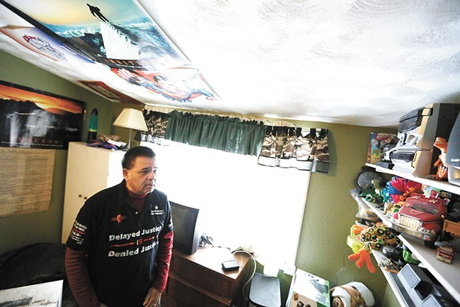 Ron Simon walks through the bedroom of his son, who hasn't been home in nearly three years - YOUNG KWAK