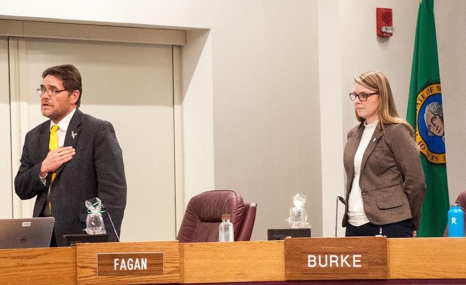 Council members Mike Fagan (left) and Kate Burke during the Pledge of Allegiance. - DANIEL WALTERS PHOTO