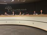 The Spokane Public Schools Board of Directors and superintendent Shelley Redinger (right).