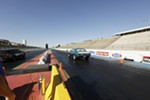 Miss Shifters member Jessica Boller, right, drives her 1967 Chevrolet Camaro in a Powder Puff time trial.