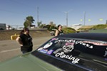 Miss Shifters members Shelly Walsh, left, and Heather Eller speak with Treasurer Annette Callesto, who is sitting in her 1969 Chevrolet Camaro, before a Powder Puff time trial.