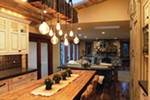 To add a focal point to this kitchen, Shaleesa Mize specified a unique light fixture crafted from reclaimed wood by Spokane's Dare Designs.