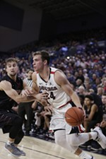 Gonzaga forward Corey Kispert drives the ball while defended by Central Washington guard Jackson Price during the first half of an NCAA college basketball exhibition game in Spokane, Nov. 1.