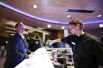 Bartender Travis Tsoumpas, right, makes a Tanqueray and club soda for Brandon Kerr in the bar during the opening of the First Interstate Center for the Arts in Spokane, Wash., Monday, Nov. 5, 2018.