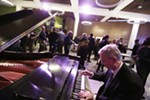 Centerplate General Manager Stan Hoff plays the piano in the bar during the opening of the First Interstate Center for the Arts in Spokane, Wash., Monday, Nov. 5, 2018.