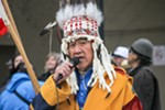Dave Brown Eagle talks with a gathering of hundreds of people in front of Spokane City Hall just before the Indigenous Peoples March on Friday, Jan. 18.