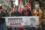 Event organizers and Native American leaders lead the Indigenous Peoples March through downtown Spokane near the Spokane Transit Authority station.