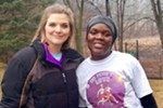 Karen Bontrager (left) founder of the No Fear in Love race, poses with a race participant.