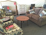Chairs, tables and headboards are deeply discounted at the Tin Roof Tent Event.