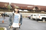 Joel Barbour wears a Great PNW Steelhead Tee, Camporee Hoodie and a camper hat from the upcoming season's line.