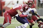 Washington State defensive lineman Garrett McBroom (99) brings down Washington running back Lavon Coleman during the second half.