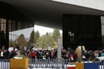 Attendees line up to enter the Spokane Convention Center for the rally.