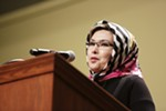 Sorayya, no last name given, a refugee from Afghanistan, speaks at a rally held at the Spokane Convention Center.