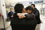 Iraqi refugee Rahaf Al-Sawaedi hugs her uncle, Hamid Nahir.