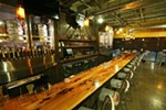 Manito Tap House offers more than a hundred beers on tap and in bottles and cans.