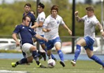Spokane Shadow defender David Starkovich, left, goes after the ball against FCM Portland midfielder Ryo Asai, center, and Ryan Middleton during the first half.