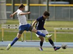 Spokane Shadow midfielder Isaiah Jackson, right, dribbles the ball while defended by FCM Portland defender Brady Voge during the second half.