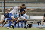 Spokane Shadow midfielder JD Hauenstein, right, dribbles the ball while defended by FCM Portland midfielder Daniel Allred  during the second half.