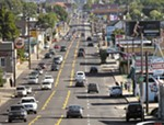 The Monroe Street city project has inspired a lawsuit from some of the road's business owners.