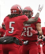 Eastern Washington wide receiver Nsimba Webster (5) celebrates his touchdown with teammate Eastern Washington running back Sam McPherson (20) during the first half of an NCAA college football game against Montana State in Cheney, Wash., Saturday, Oct. 14, 2017. (Young Kwak/The Inlander)