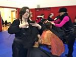Savannah Mackey gives Hector Ortiz a haircut at Homeless Connect in 2014.