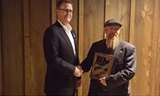 "Rep. Matt Shea presents Oregon-standoff figure Bosworth with ""2016 Patriot of the Year"" award."