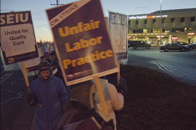 Union members and supporters march outside Valley Hospital as the sun comes up Wednesday. - JACOB JONES