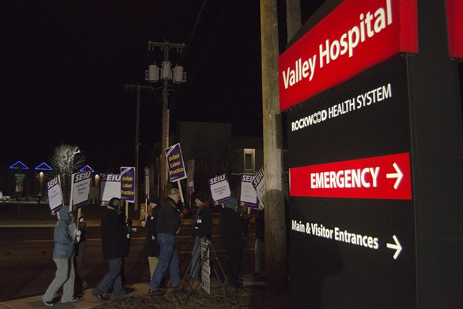 Union workers and supporters march outside Valley Hospital shortly after 6 am Wednesday during 24-hour strike. - JACOB JONES