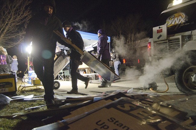 Union workers pick up protest signs for the picket line outside Valley Hospital early this morning. - JACOB JONES