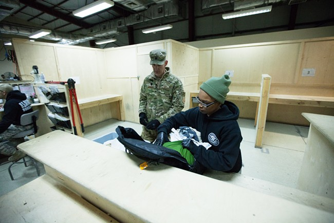 US Army 391st Military Police Battalion Detachment 5 Sergeant Clarissa Giles, right, checks a bag belonging to US Air Force Headquarters Lieutenant Colonel John Howard. - YOUNG KWAK