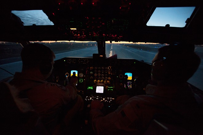 USAF Pilot Captain Joe D'Agostino, left, and Co-Pilot 1st Lieutenant Jacob Mueller steer a KC-135 during takeoff at Fairchild Air Force Base. - YOUNG KWAK