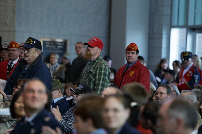 Veterans stand when their service is acknowledged during a Veterans Day Ceremony. - YOUNG KWAK