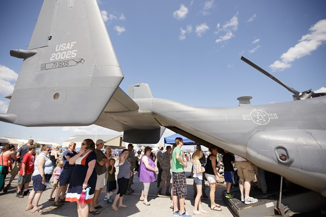 Visitors line up to enter a V-22 Osprey. - YOUNG KWAK