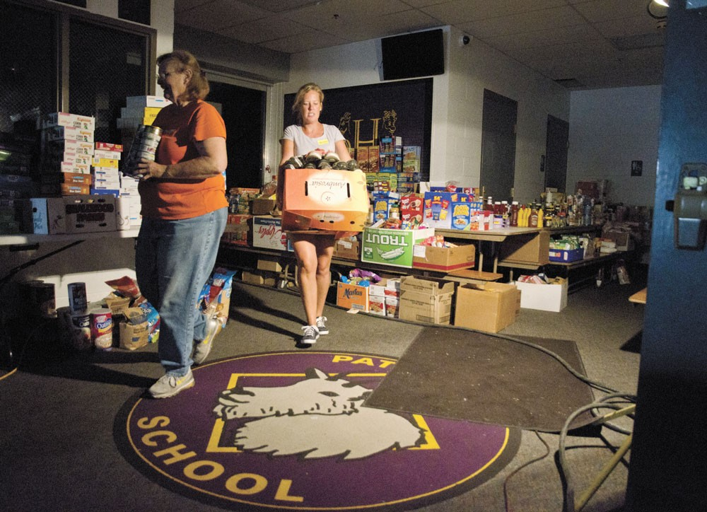 Volunteers sort and inventory donations at a relief center at Pateros High School for area residents displaced by the Carlton Complex Fire. - JACOB JONES