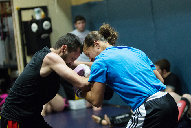 Elizabeth Phillips spars with Sik-Jitsu teammate Ron Nance during a recent training session. - YOUNG KWAK