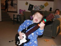 _resized_300x224_kid_rocking_out_on_guitar_hero.jpg