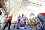 "West Valley High School's team ""Chuck"" fire frisbees from their robot during a 1st Robotics demonstration."