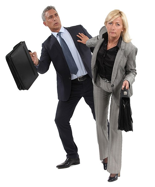 businesswoman pushing a colleague