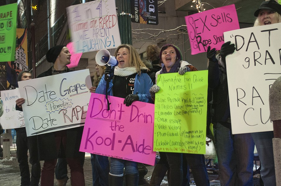 Protesters gather outside the Spokane Downtown Daiquiri Factory on Feb. 1 to protest the name of a drink on the menu. - SARAH WURTZ