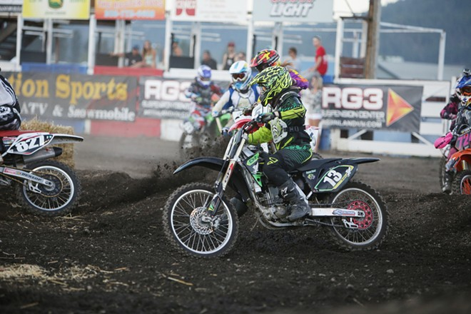 Women's amateur rider Angelique Wetherelt (13), from Post Falls, Idaho, takes a turn in a Moto 1 race. - YOUNG KWAK
