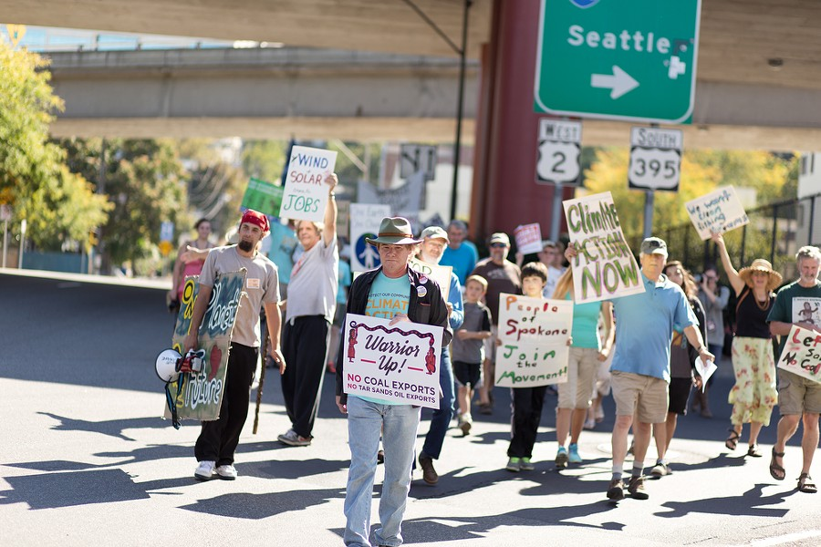 Ziggy Siegfried, center, marches north on S. Browne St. - YOUNG KWAK